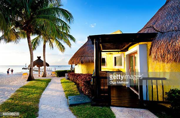 CONTENT] Colorful huts of Iberostar Cozumel Resort Mexico