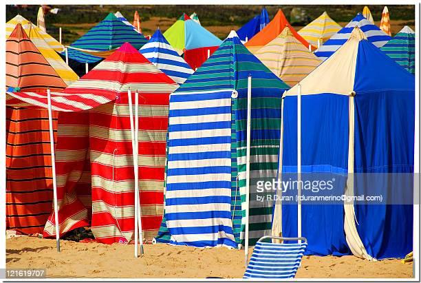 colorful huts on beach - gijon fotografías e imágenes de stock