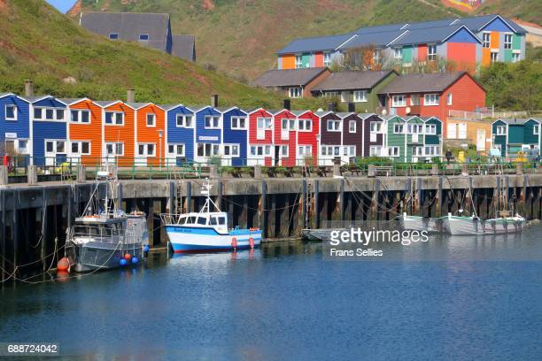 Colorful huts, shops, houses, boats around the harbor on Helgoland, Germany