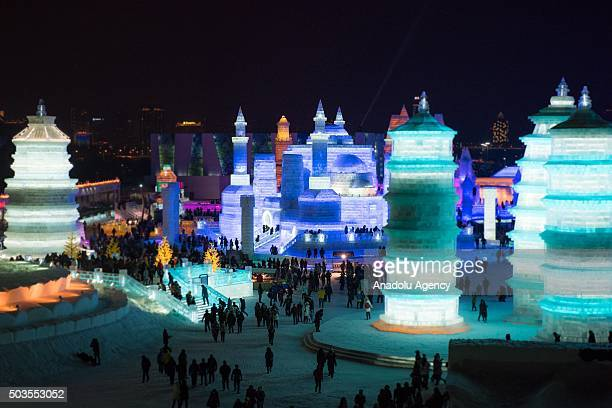 Colorful ice towers and the ice castle are seen during the 32nd Harbin Ice Festival in Harbin China on January 6 2016 The main attraction is the...
