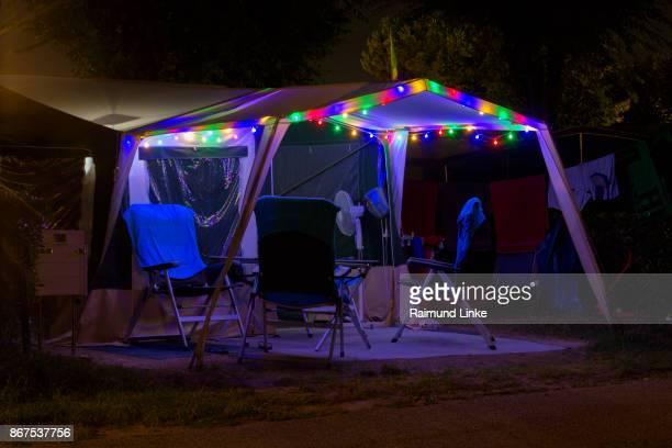 Colorful illuminated tent at campsite, Lake garda, Lago di Garda, Veneto, Italy