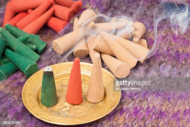 colorful incense cones - cone shape stock photos and pictures