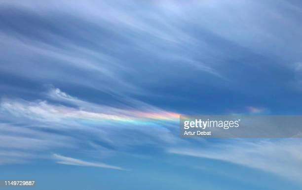 colorful iridescence in the sky during windy day. - rainbow sky stock pictures, royalty-free photos & images