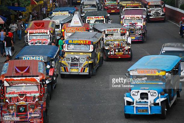 Colorful jeepneys ply their routes in Manila on October 5 2012 in Manila Philippines A group of local artists and sculpturs are recreating the Manila...