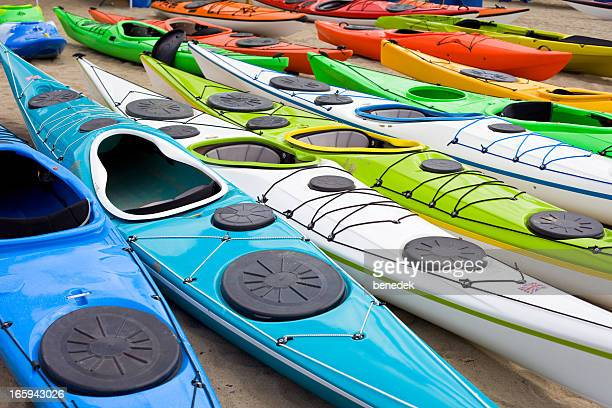 Colorful Kayaks in a Row