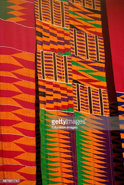 Colorful kente cloth produced in the weaving craft village of Adanwomase in the Ashanti Region of Ghana West Africa Kente cloth is worn by Ghana...