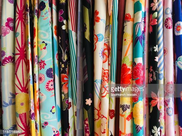 colorful kimono - multi coloured dress stock pictures, royalty-free photos & images