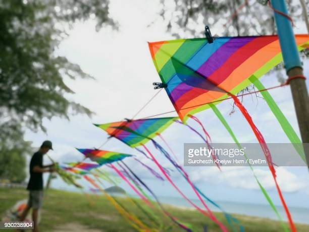 Colorful Kites On Clothesline Against Sky