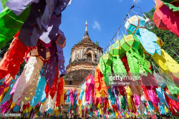 colorful lamp festival and lantern in loi krathong at wat lok moli is a beautiful old temple in chiang mai - yi peng stock pictures, royalty-free photos & images