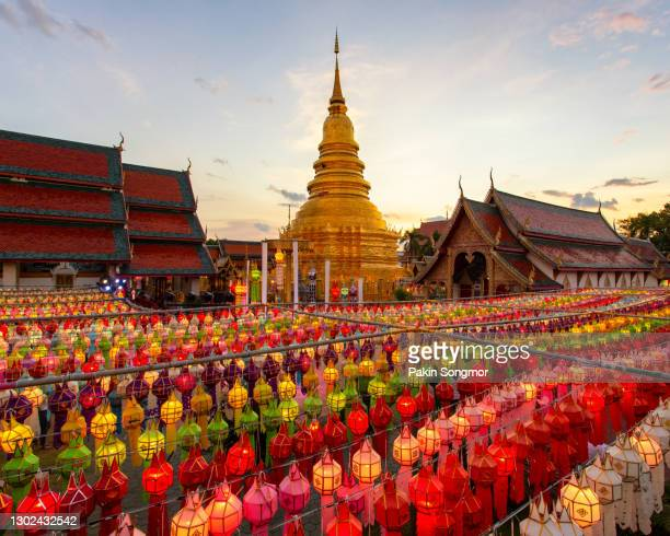 colorful lamp festival and lantern in loi krathong at wat phra that hariphunchai - traditional festival stock pictures, royalty-free photos & images