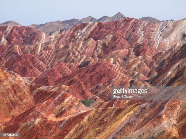 colorful landforms in zhangye danxia park, gansu, china - tectonic stock photos and pictures