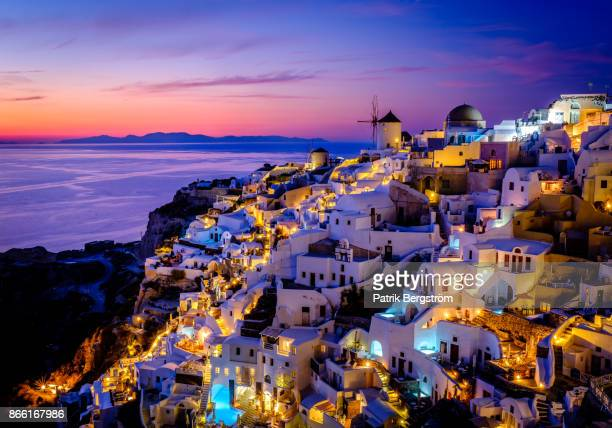 Colorful landscape photo of the traditional village of Oia during dusk
