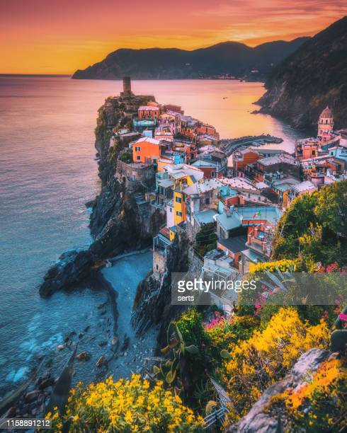 colorful landscape view of vernazza on sunset in cinque terre, liguria, italia - italy stock pictures, royalty-free photos & images
