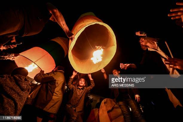 Colorful lanterns lift into in the night sky of Leonidio a seaside town in the Peloponnese to mark the Ressurection of Christ celebrated by the Greek...