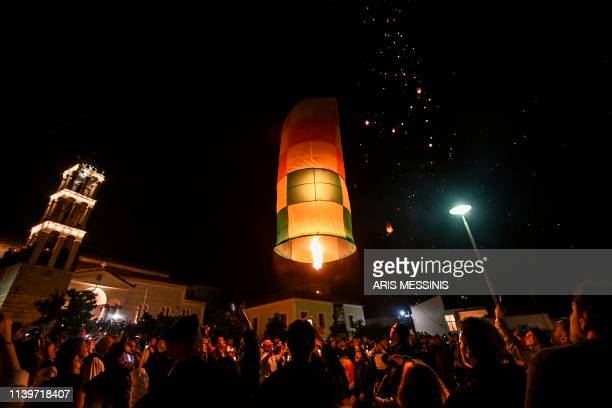 TOPSHOT Colorful lanterns lift into in the night sky of Leonidio a seaside town in the Peloponnese to mark the Ressurection of Christ celebrated by...