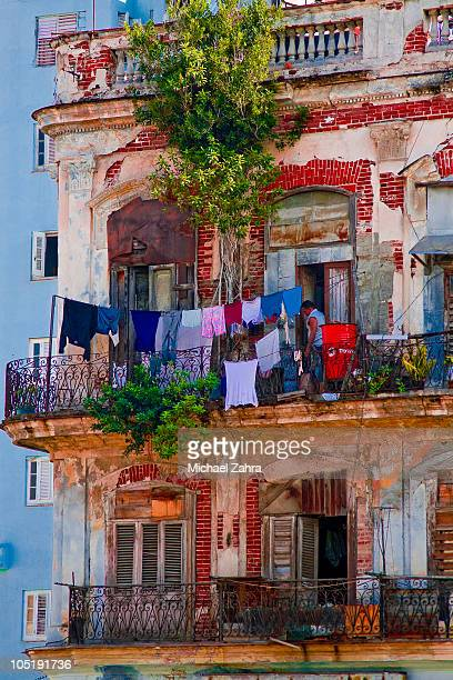 Colorful laundry hanging in an old Havana building.