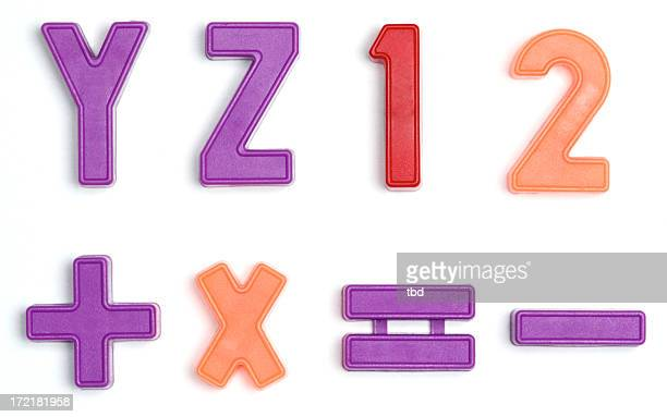 Colorful letter magnets on a white background