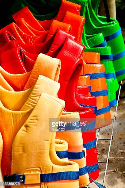 Colorful life vests in a row.