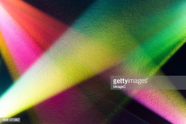 colorful light beam shining on paper texture - spectrum stock photos and pictures