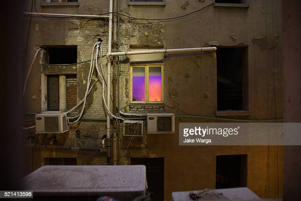 colorful light in alley window, cairo, egypt - jake warga stock pictures, royalty-free photos & images