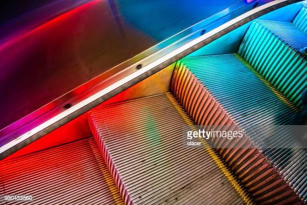 colorful light in escalator - shopping centre stock photos and pictures