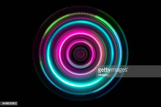 colorful light trail swirl - strudel geometrische form stock-fotos und bilder