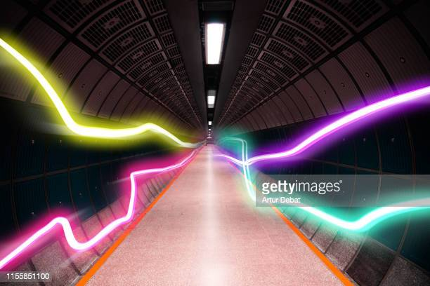 colorful light trails in cool underground tunnel with nice vanishing point. - international space station stock pictures, royalty-free photos & images
