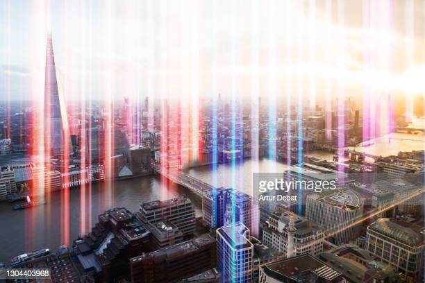 colorful lights emerging from the city of london with global connections. - the media stock pictures, royalty-free photos & images