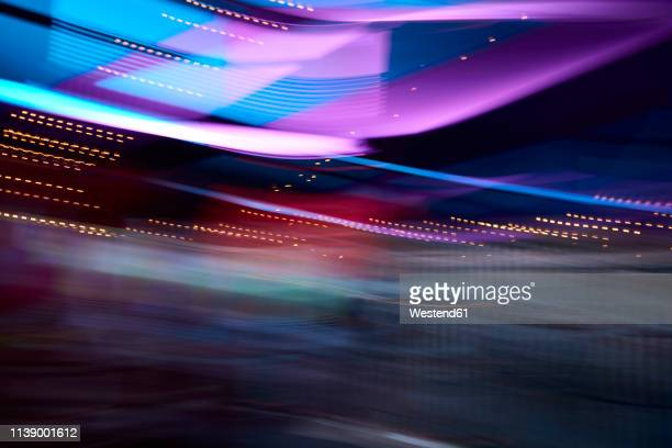 colorful lights in movement, long exposure - lighting equipment stock pictures, royalty-free photos & images