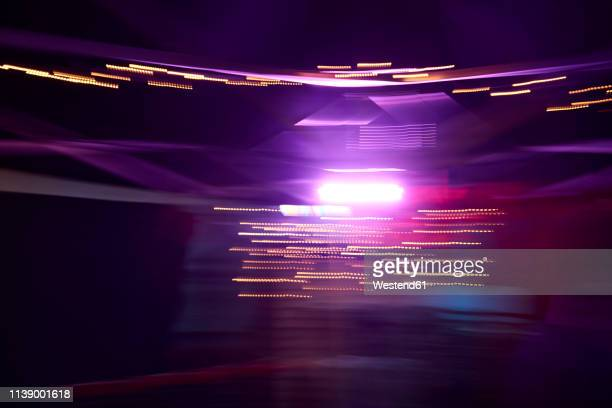 colorful lights in movement, long exposure - magenta stock pictures, royalty-free photos & images