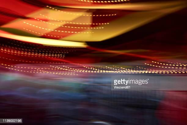 colorful lights in movement, long exposure - ディスコ照明 ストックフォトと画像