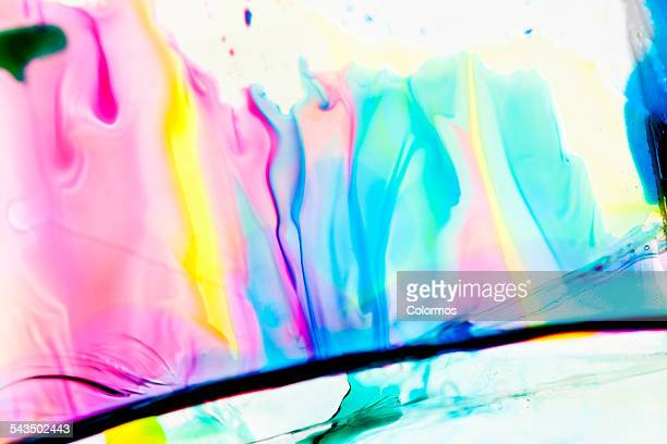 Colorful liquid on glass, close-up