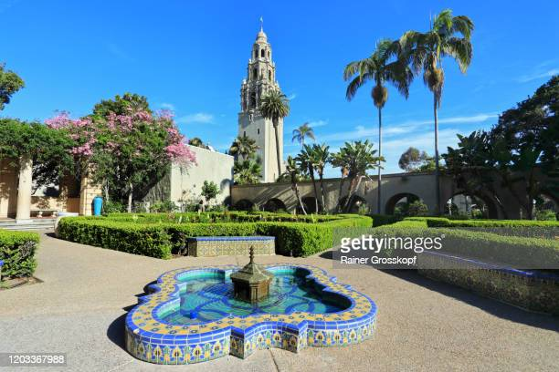 colorful little fountain pond with mosaic in front of a spanish style church tower - rainer grosskopf fotografías e imágenes de stock