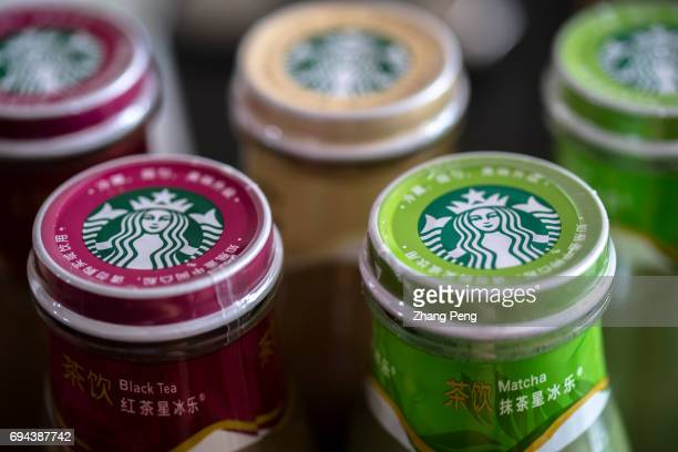 Colorful logos on caps of different tastes of Starbucks bottled Frappuccino In the first quarter of 2017 targeting to the Chinese consumers Starbucks...