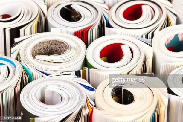 colorful magazines up close - rolled up composition - medienwelt stock-fotos und bilder