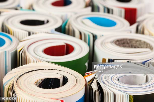 colorful magazines up close - rolled up composition - magazine cover stock pictures, royalty-free photos & images