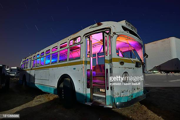 colorful magic party bus at night in junkyard - magic bus bildbanksfoton och bilder