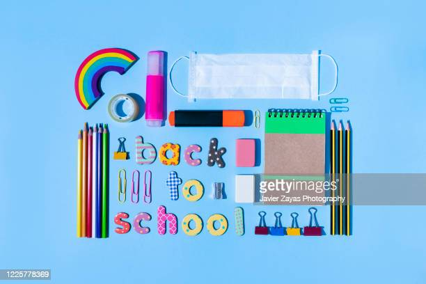 """colorful magnetic letters forming the words """"back to school"""" surrounded by stationery - school supplies stock pictures, royalty-free photos & images"""