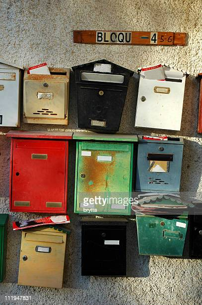 Colorful mailboxes at the entrance of a building with apartments.