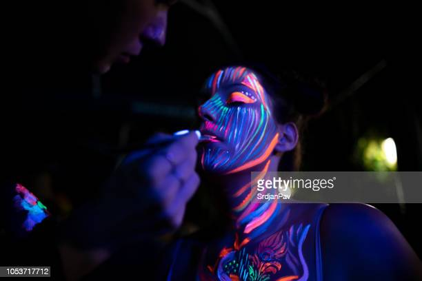 colorful makeover - body paint photos stock photos and pictures