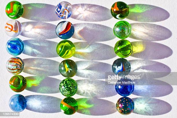 Colorful marbles and shadows