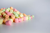 colorful marshmallows white background with copy