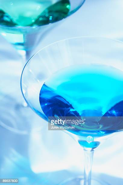 colorful martinis on watery background