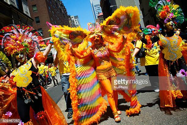 Colorful masks and costumes form part of a parade along Madison Avenue at the 116th anniversary celebration of the Philippine independence in New...