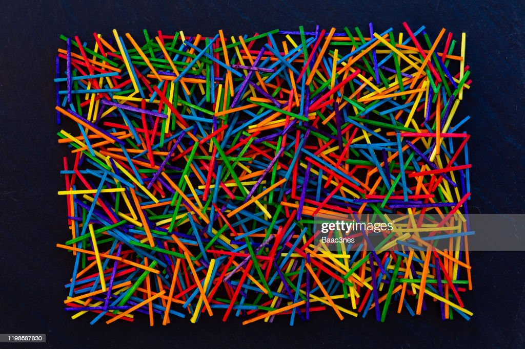 Colorful matches / wooden sticks on black rock tile : Stock Photo