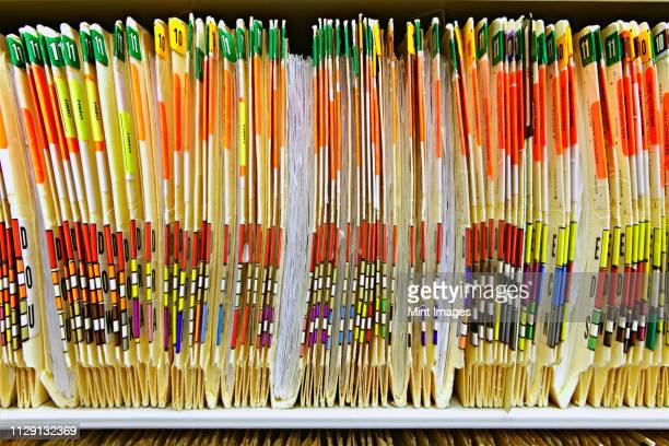 colorful medical folders - ring binder stock pictures, royalty-free photos & images