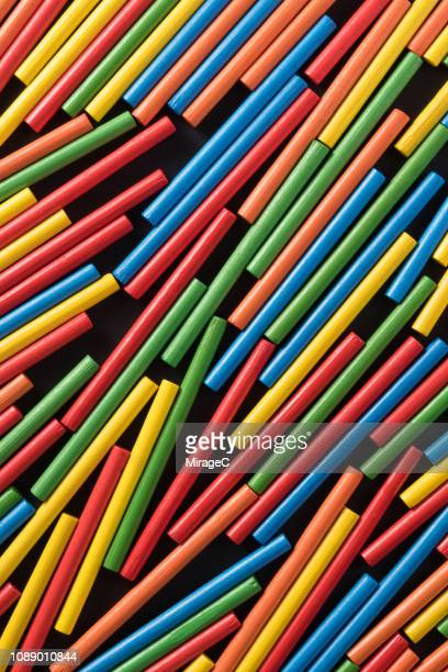colorful messy wood sticks - miragec stock pictures, royalty-free photos & images