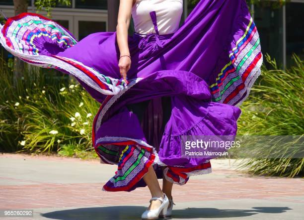 colorful mexican folklorico dancer - purple skirt stock pictures, royalty-free photos & images