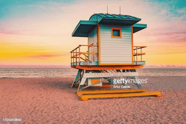 colorful miami beach lifeguard tower with stunning sunset sky and empty beach. - miami beach stock pictures, royalty-free photos & images