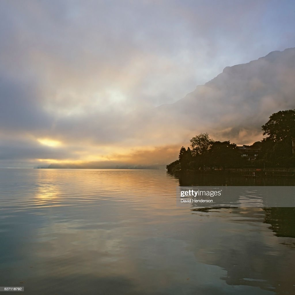Colorful misty dawn on lake : Stockfoto